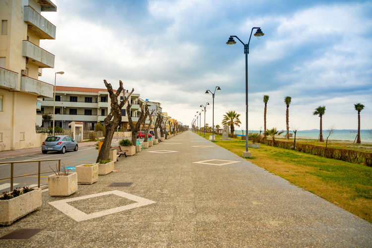 Italy Sicily Direction The Way Forward Architecture Building Exterior Street Cloud - Sky Sky Built Structure Road Transportation Diminishing Perspective Street Light Nature City Lighting Equipment Day vanishing point Footpath In A Row Outdoors No People Long