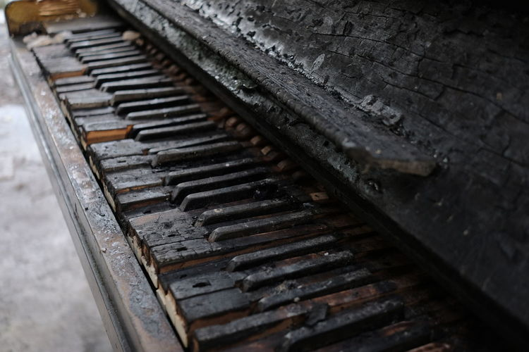 High angle view of rusty damaged piano