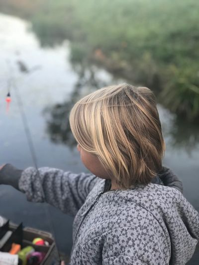 A fun afternoon of fishing. Lake Fall Water Fishing EyeEm Selects Real People Rear View One Person Focus On Foreground Day Lifestyles Leisure Activity Nature Blond Hair Outdoors Warm Clothing Standing