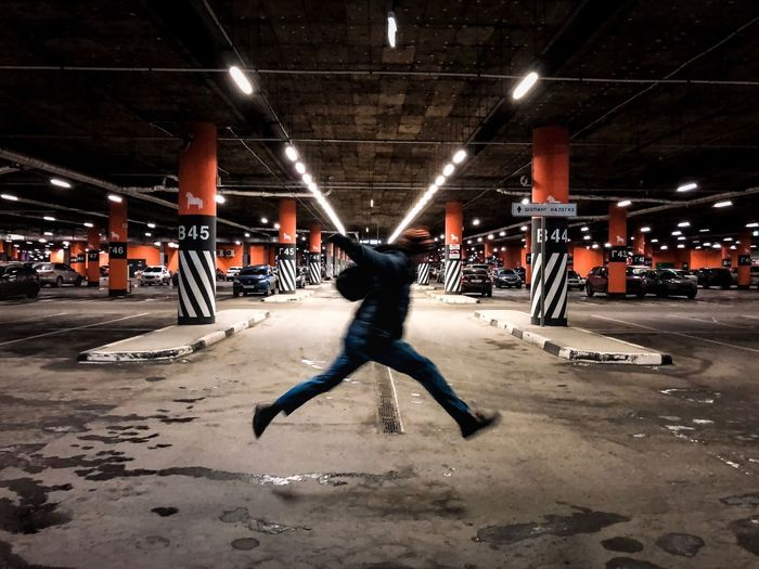 Man tearing Lifestyles Illuminated Real People Night Leisure Activity One Person Built Structure Sport Men Motion Full Length Architecture Performance City Human Arm Outdoors