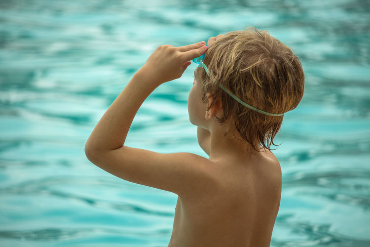 Rear View Of Boy In Swimming Pool