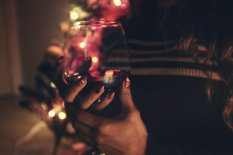 One Person Real People Indoors  Hand Human Hand Holding Leisure Activity Selective Focus Lifestyles Drink Refreshment Human Body Part Glass Glass - Material Food And Drink Women Close-up Focus On Foreground Nail Finger Nail Art Wine Christmas Christmas Lights christmas tree