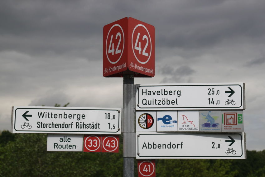 Havelradweg Close-up Cloud - Sky Communication Day Guidance No People Outdoors Red Road Sign Sky Text Warning Sign Western Script An Eye For Travel Summer Exploratorium The Traveler - 2018 EyeEm Awards Summer Road Tripping
