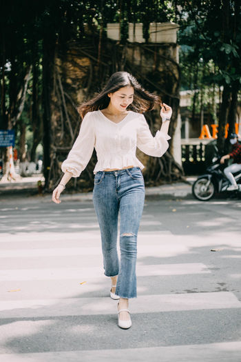 I see she walking road street and i take photo picture Young Women City Road Lifestyles Hairstyle Betiful Jeans Outdoors