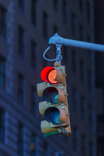 Please stop! Focus On Foreground Architecture Building Exterior Hanging No People Built Structure City Low Angle View Day Outdoors Stoplight Close-up Multi Colored Light Building Communication Illuminated Metal Road Signal Safety Red Light