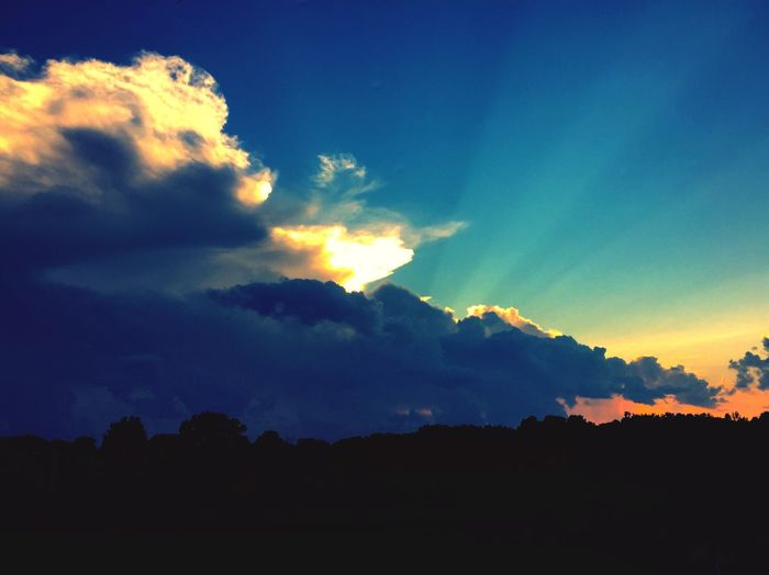 Back Lit Beauty In Nature Blue Cloud Cloud - Sky Dark Dramatic Sky Idyllic Landscape Majestic Mountain Nature No People Non Urban Scene Non-urban Scene Orange Color Outdoors Scenics Sky Sun Sunbeam Sunlight Sunset Tranquil Scene Tranquility