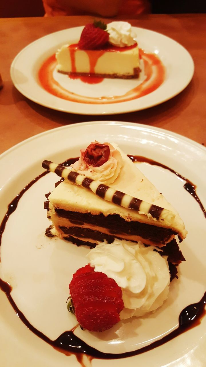sweet food, dessert, plate, food and drink, food, cake, indulgence, freshness, unhealthy eating, chocolate, indoors, temptation, ready-to-eat, close-up, no people, serving size, ice cream, dessert topping, cheesecake, day