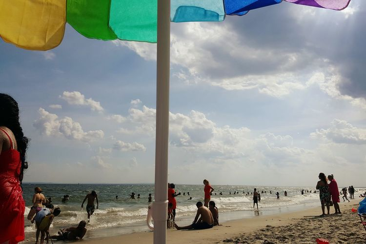 The Beach Coney Island Summertime Sand Ocean People Waves White Clouds White Clouds And Blue Sky Blue Sky Rainbow Umbrella