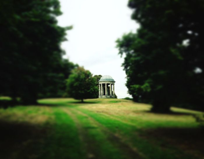 Folly Tree Tranquil Scene Solitude Sky Lawn Tranquility Day Remote Field Outdoors Countryside Green Color Surface Level Nature Grassy Footpath Beauty In Nature Place Of Worship Scenics No People Nature Beauty In Nature Tiltshift