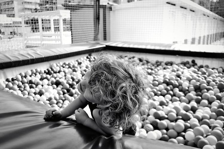 Close-up of boy in pool ball