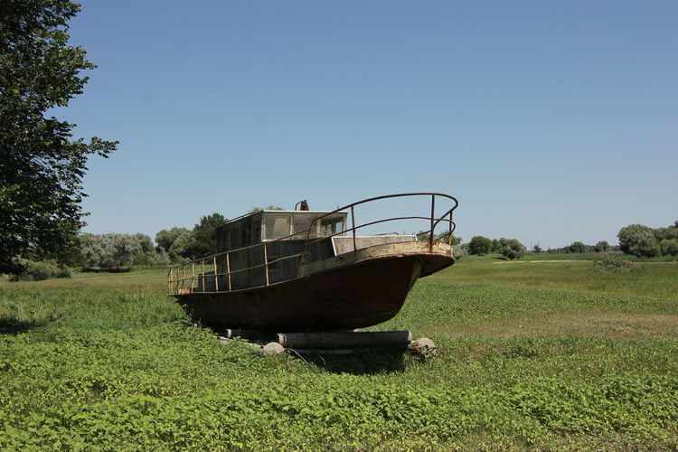Old boat. Land Sky Plant Mode Of Transportation Grass Nature Field Transportation Day Clear Sky Copy Space Landscape No People Abandoned Green Color Outdoors Old Obsolete Non-urban Scene Sunlight Old Boat Boat Summer Volga Astrakhan