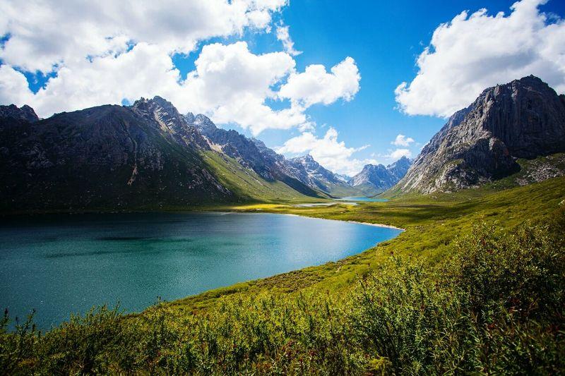 Calm lake along countryside landscape