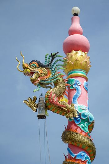 Chinese dragon statue art on post Worship Art And Craft Chinese Dragon Clear Sky Close Up Day Dragon Low Angle View Multi Colored No People Outdoors Religion Religion And Beliefs Sculpture Sky Spirituality Statue Worship Place