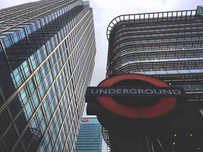Underground and skyscrapers Communication Text Architecture Low Angle View Built Structure Day Building Exterior Road Sign Outdoors City Skyscraper No People Sky Cityscape Modern The Week On EyeEm Skyscrapers London Low Angle View Architecture City Life Travel Moody City City View  Postcode Postcards 10