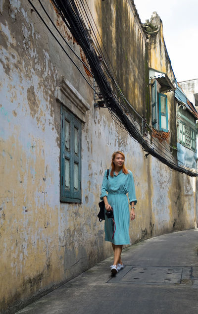 Antique Asian  Bangkok Composition Orientation Thai Thailand Tourist Woman Adult Architecture Blue Dress Building Exterior Built Structure Day Explorer Female Full Length Old Buildings One Person Outdoors Portrait Vertical Walking Young Adult