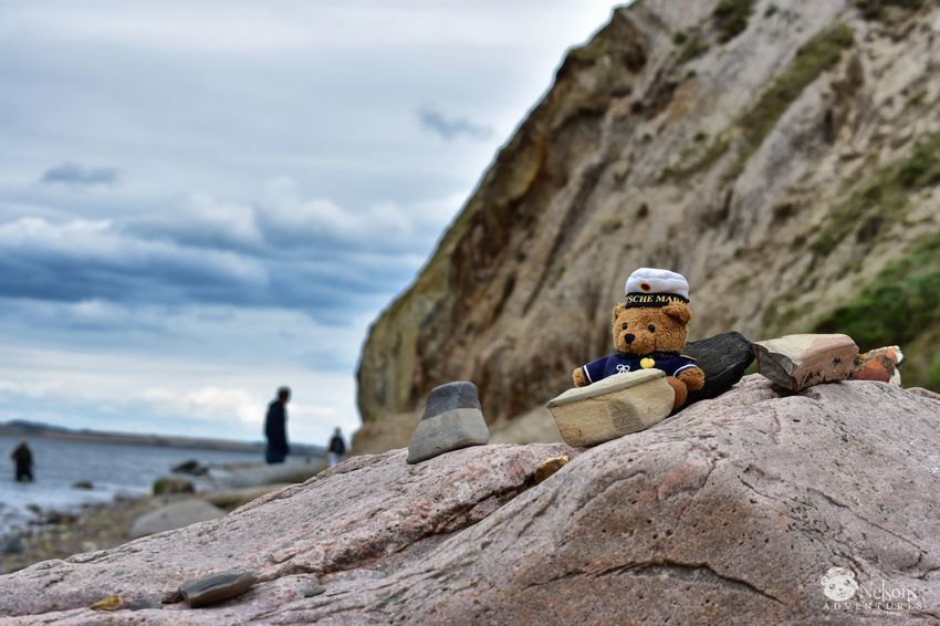 Nelson in front of Hanklit on Mors Island in Denmark. NelsonsAdventures Hanklit Denmark Mors Cliff Limfjord Limfjorden Fjord Landscape Rock - Object Beach Nature EyeEm Nature Lover Nature_collection EyeEm Masterclass Denmark 🇩🇰 Teddy Teddy Bear Stuffed Toy Sky Stones Landscape_Collection Stones And Pebbles Travel Destinations Watching The Sea