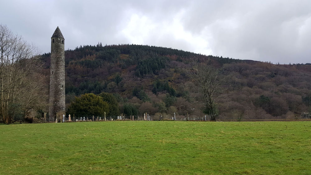 Architecture Built Structure Day Glendalough Grass Mediaeval Monastic Settlement Outdoors Round Tower