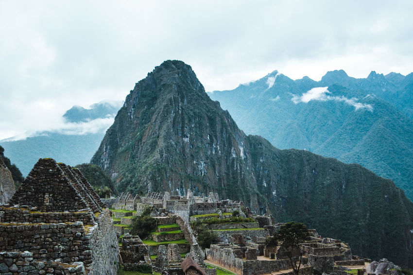 Discover Your City Morning Aguas Calientes Ancient Civilization Archaeology Architecture Building Exterior Built Structure Clouds Day Explore Fog History Mist Moody Mountain Mountain Peak Mountain Range Nature No People Old Ruin Outdoors The Past Tourism Travel Destinations