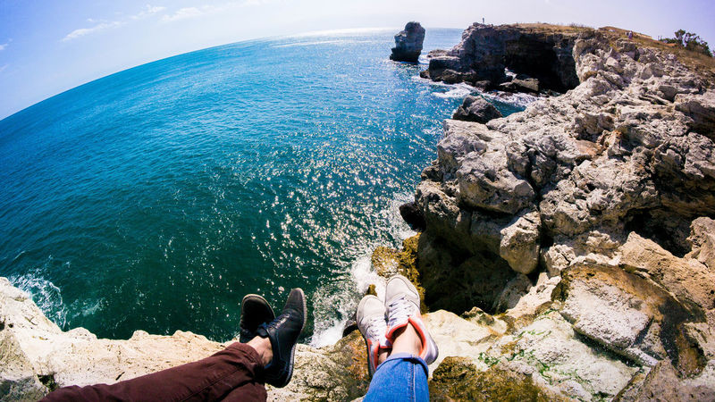 Traveling around the world together Human Leg Sea Beach Water Personal Perspective Real People Rock - Object Leisure Activity Outdoors Nature People On The Cliffs Coastline Landscape On The Edge . Bulgaria Tyulenovo The Week On EyeEm