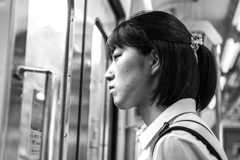 Lost in her own thought, this girl looked outside the window of the train. The train was rumbled through the outskirts of Tokyo and was nearing the next station. ASIA City City Life Contemplation Japan Looking Out Metro Tokyo Tokyo,Japan Travel Beautiful Woman Black And White Black Hair Casual Clothing Close-up Commute Contemplation Focus On Foreground Girl Hairstyle Headshot Human Face Leisure Activity Lifestyles Looking Looking Away One Person People Portrait Profile View Real People Side View Street Train Women Young Adult Young Woman Young Women The Street Photographer - 2018 EyeEm Awards