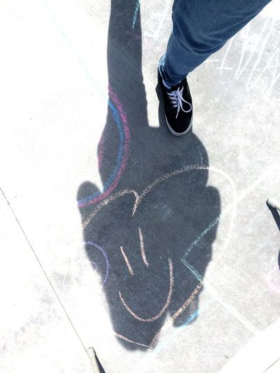 At my school we had a day where we wrote all over the floor in chalk. This one was my favorite because even though they clearly weren't the best artist, they still sought to spread kindness. EyeEmNewHere Positivity Love Chalk Creativity Shadow Low Section Human Body Part Shoe High Angle View Sunlight Real People