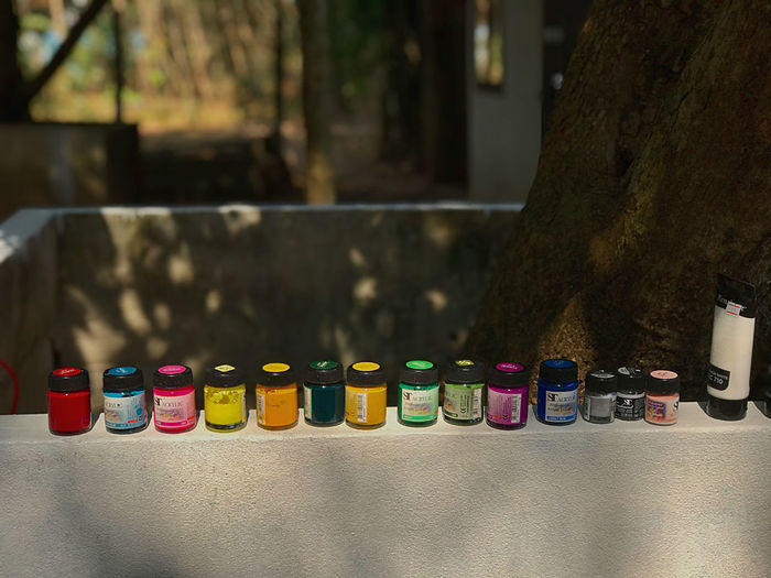 Close-up of multi colored bottles on table