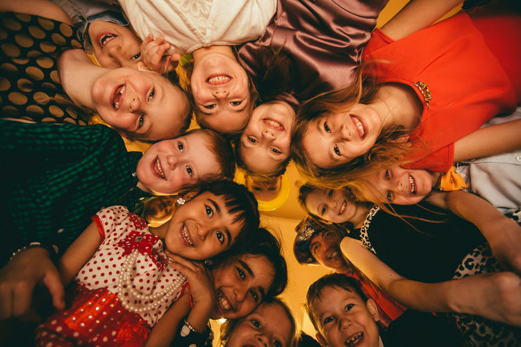 Happy children Child Childhood Emotion Females Friendship Girls Group Of People Happiness High Angle View Indoors  Innocence Leisure Activity Lifestyles Looking At Camera Males  Men Mouth Open Portrait Positive Emotion Real People Smiling Togetherness Women