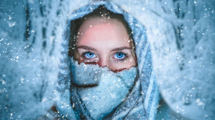 Portrait of mature woman with snow covered face