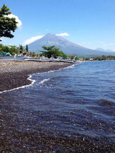 Bali Holiday INDONESIA Mount Agung Travel Traveling Vacations Wanderlust Amed Amed Beach , Bali Beauty In Nature Day Explore Lake Mountain Mountain Range Nature No People Outdoors Scenics Sky Tranquil Scene Tranquility Travel Destinations Tree Water