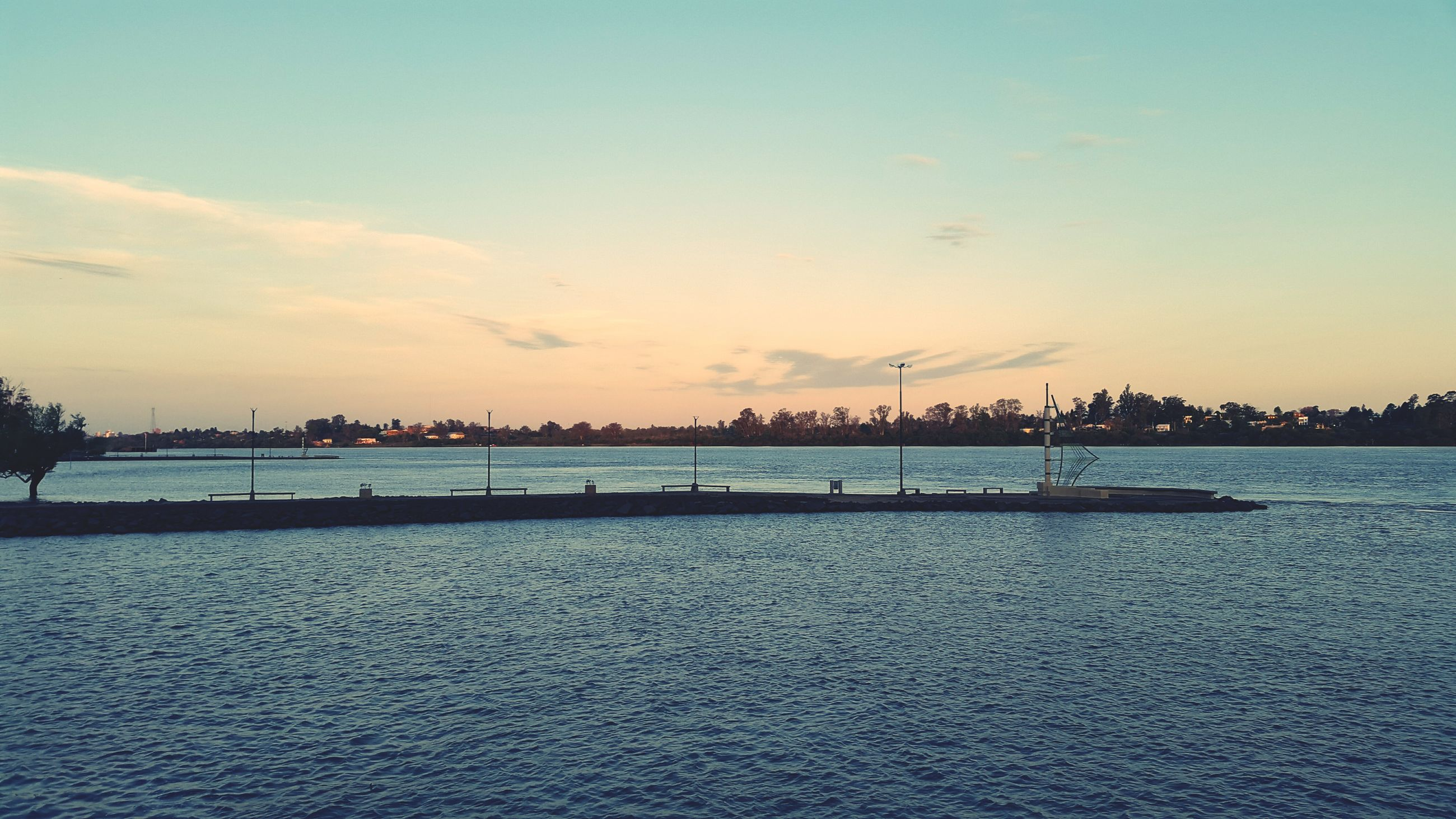 water, sunset, waterfront, tranquil scene, tranquility, sky, scenics, beauty in nature, sea, nature, silhouette, rippled, idyllic, river, outdoors, lake, no people, dusk, cloud - sky, reflection