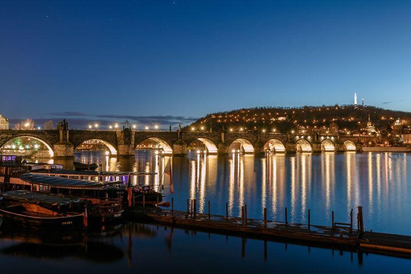 Reflection of illuminated  bridge over water