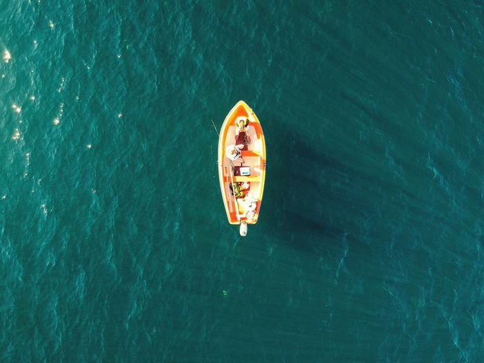 Aerial view of a lonely rowboat at sea