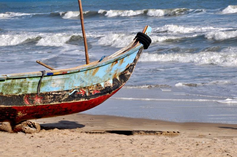Side view of boat on beach