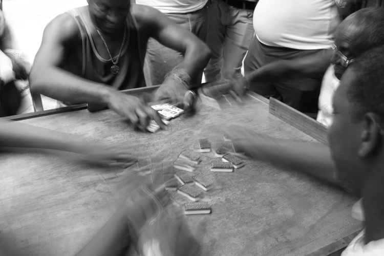High angle view of people playing dominoes
