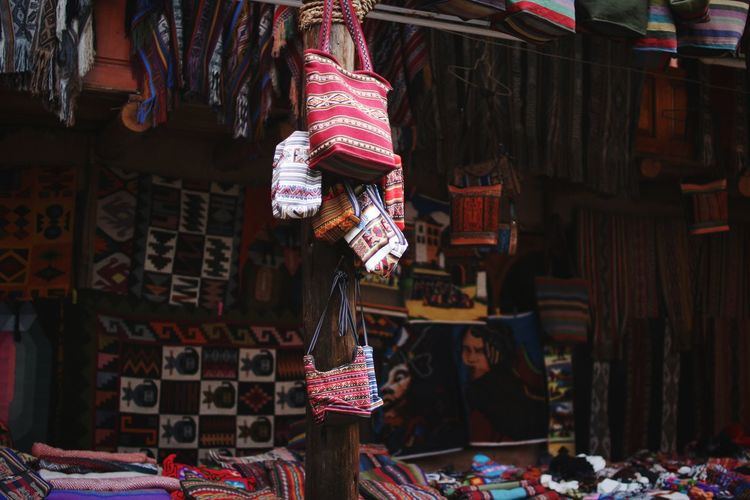Clothes hanging at market stall for sale