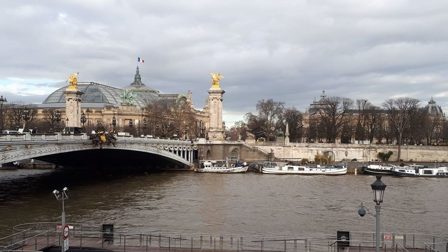 Tourism Tourist Attraction  No Filter Grand Palais Museum Bridge Pont Alexander III Water La Seine French Flag Statues And Monuments Statues Golden Barge Metallic Structure Architecture History Travel Destinations Cloud - Sky Bridge - Man Made Structure