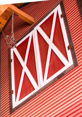 Farm door opening decoration with a pully system. Red Pattern No People Architecture Low Angle View Built Structure Day Wood - Material Outdoors Roof Close-up Full Frame White Color Shape Security Design Hanging Protection Ceiling Barn Door Pulley Closed A New Perspective On Life