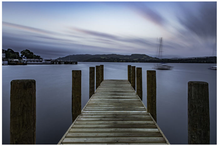 Windermere jetty Lake District Beauty In Nature Built Structure Cloud - Sky Direction Jetty Lake Lake View Long Nature No People Outdoors Pier Post Scenics - Nature Sky Tranquil Scene Tranquility Transfer Print Water Windermere Wood Wood - Material Wood Paneling Wooden Post