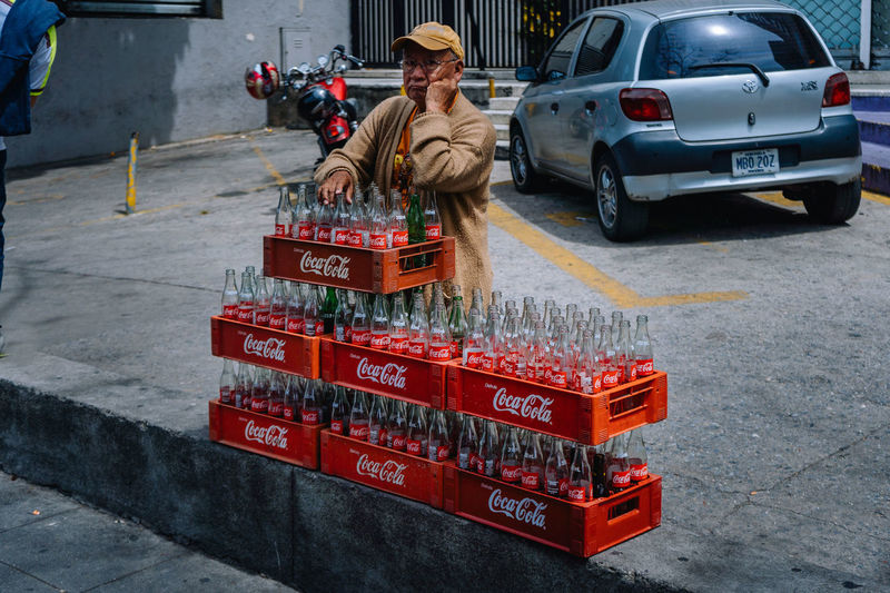 Out of Coca Cola. Streetphoto Street Photography Streetphotography EyeEm Selects EyeEm Best Shots Government Outdoors Real People Adult Red Day Container Road Box Standing One Person Men Land Vehicle Occupation City Motor Vehicle Street Car Mode Of Transportation Transportation Cocacola Drink The Street Photographer - 2019 EyeEm Awards