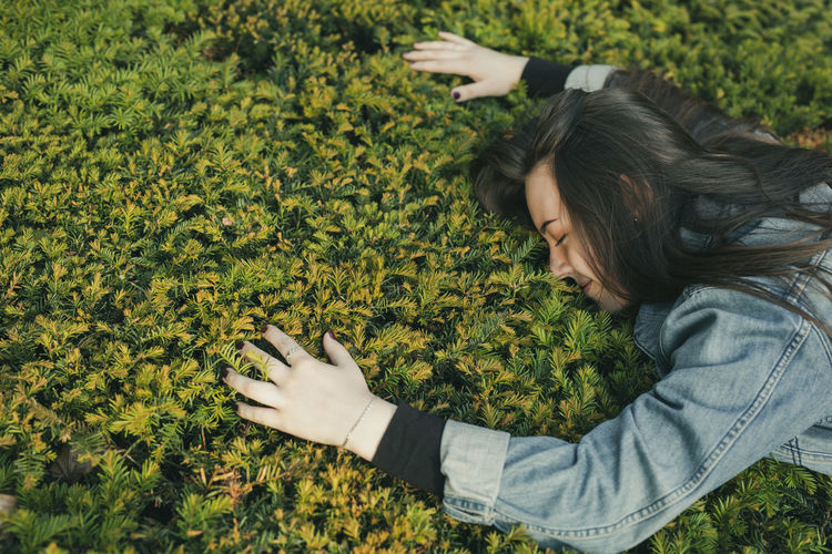 Young woman on plants