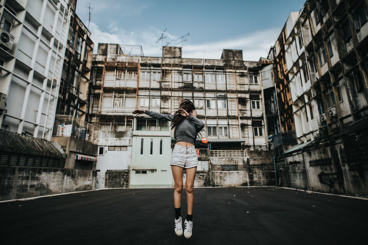 One Person Building Exterior Full Length Architecture Built Structure Casual Clothing Young Adult Real People City Lifestyles Standing Leisure Activity Day Building Young Women Front View Women Nature Outdoors Shorts Hairstyle