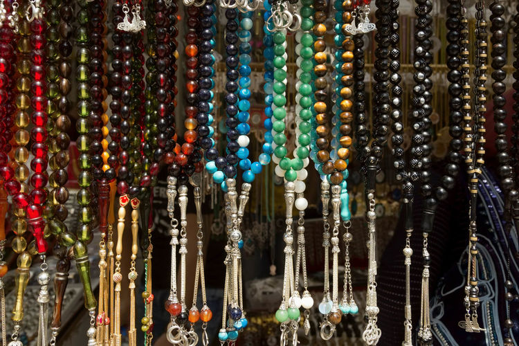 Prayer Beads Abundance Arrangement Backgrounds Color, Colorful, Blue, Yellow, Green, Striking, Full Frame Hanging In A Row Large Group Of Objects Multi Colored Prayer Beads Repetition Round, Circle, Beads, Jewels, Shop, Sale, Side By Side Silver  Souvenirs/Gift Shop Worry Beads