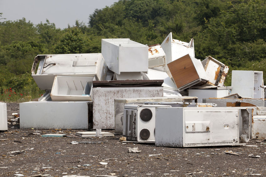 Old home appliances dumped at the landfill Contamination Disposal Fridge Garbage Dump Nature Stove Consumerism Consumption  Dump Environment Freezer Fridges Garbage Home Appliances Household Appliances Junkyard Kitchen Stove Landfill Old Outdoors Pollution Recycle Recycling Recycling Center Waste