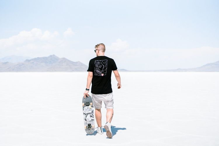 Walking to the spot Skateboarder Skateboarding Full Length One Person Nature Sky Lifestyles Day Casual Clothing Leisure Activity Land Beauty In Nature Scenics - Nature Landscape Young Adult Standing Adult Real People Environment Desert Outdoors