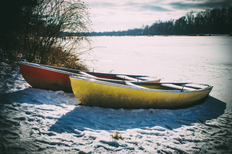 Boats on ice Beauty In Nature Boats Boats On Ice Cold Temperature Kayak Lake Nature Nautical Vessel No People Outdoors Snow Vacations Winter
