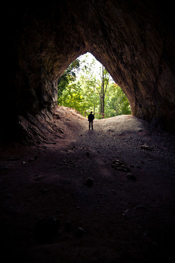 Adult Adventure Architecture Beauty In Nature Cave Dark Day Escape Exploration Extreme Sports Full Length Hiking Leaving Light At The End Of The Tunnel Mystery Nature One Person Real People Rear View Silhouette Tunnel Under Underground Walking