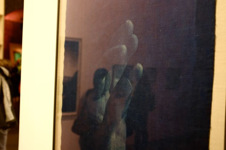 Close-up of hand on window