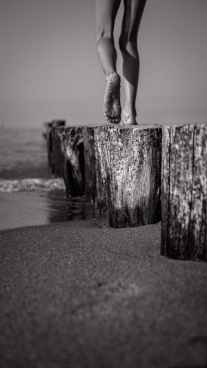 Black and White Edition to the Beach ... Baltic Sea Beach Black And White Black And White Photography Blackandwhite Photography Body Part Day Focus On Background Human Body Part Human Foot Human Leg Human Limb Land Landscape_photography Leisure Activity Lifestyles Low Section Nature People Real People Sand Sea Selective Focus Standing Water