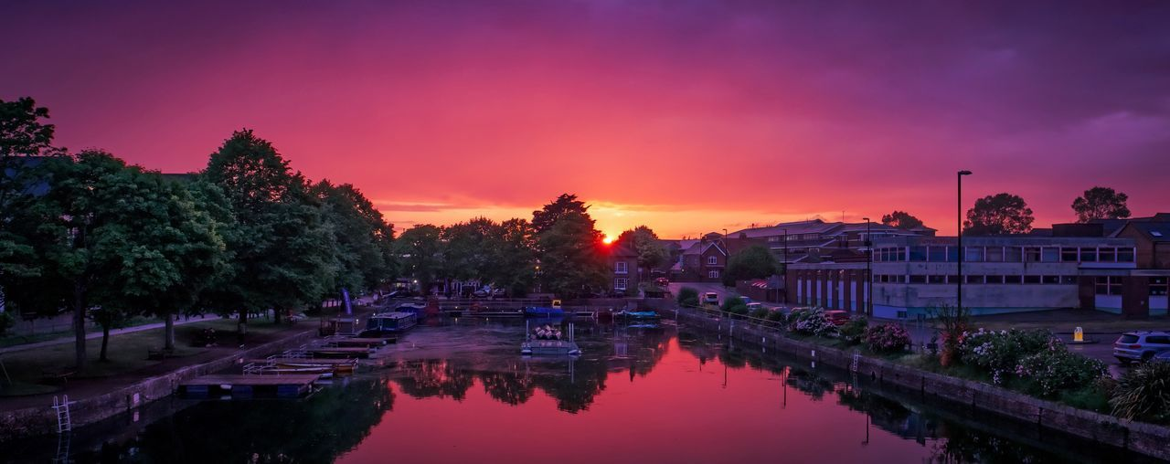 Water Sky Sunset Reflection Tree Nature Plant Architecture Dusk Lake Pink Color Built Structure No People Cloud - Sky Building Exterior Beauty In Nature Purple Waterfront Outdoors