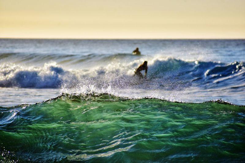 atlantic ocean waves on fuerteventura canary island in Spain Atlantic Ocean Fuerteventura Canary Islands Water Wave Power In Nature Sea Beach Motion Sunset Surfing Sky Water Sport Surf Surfboard Surfer Force Splashing